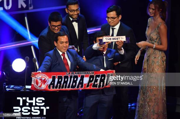 Representatives of Peru fans who visited Russia for the 2018 world cup speak after winning the trophy for the FIFA Fan Award 2018, rewarding the best...