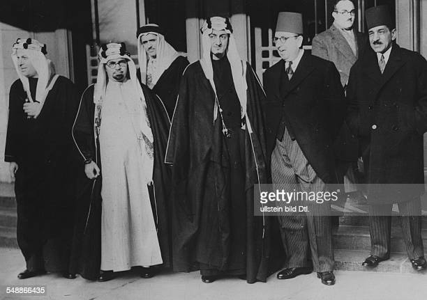 Representatives of SaudiArabia and Egypt in front of their hotel in the middle prince Faisal the eventual king of SaudiArabia Photographer...