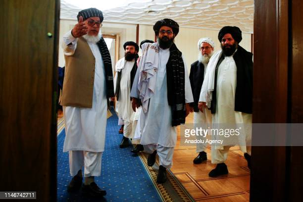 Representatives of Taliban led by Head of Political Office of the Taliban, Sher Mohammad Abbas Stanakzai and Mullah Abdul Ghani Baradar arrive for a...
