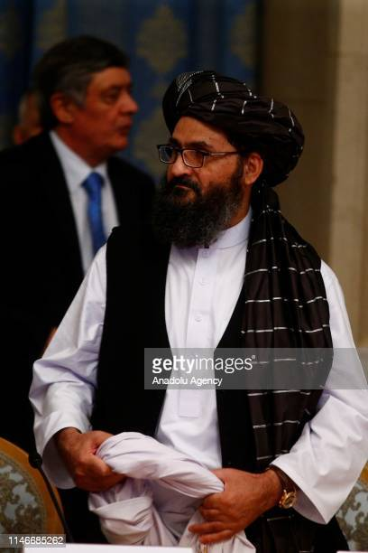 Representatives of Taliban led by Mullah Abdul Ghani Baradar attend a meeting on Afghan talks with Afghan politicians within a conference marking a...