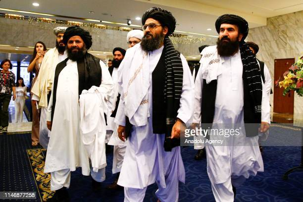 Representatives of Taliban led by Mullah Abdul Ghani Baradar attend a meeting with a political group, under the presidency of Former President of...