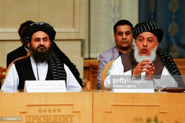 Representatives of Taliban, Mullah Abdul Ghani Baradar and Head of Political Office of the Taliban Sher Mohammad Abbas Stanakzai attend a meeting...