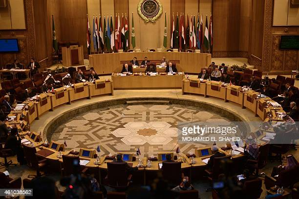 Representatives of the Arab League attend an emergency meeting to discuss the conflict in Libya at the Arab League headquarters in Cairo on January 5...
