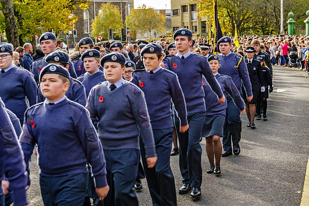 Representatives of the armed forces marching through town