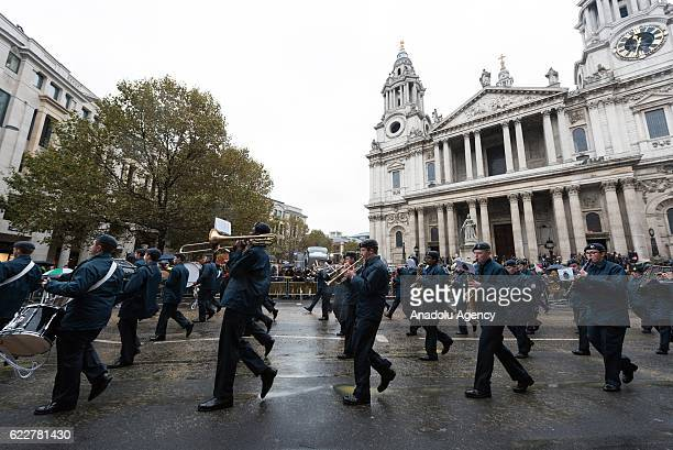 Representatives of the armed forces walk past St Paul's Cathedral take part in the Lord Mayor's Show in London United Kingdom on November 12 2016...