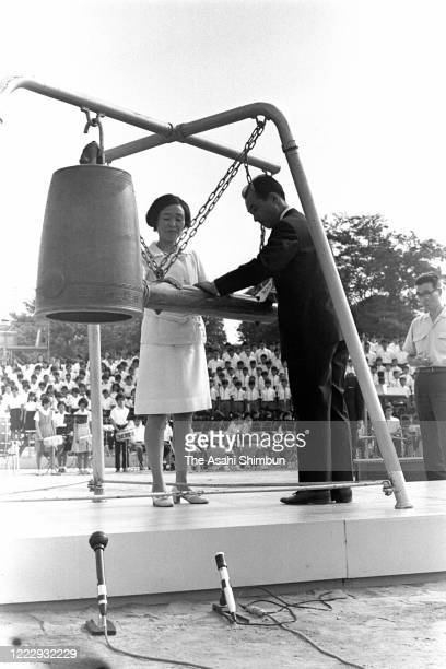 Representatives of the bereaved family members ring the Peace Bell during the Peace Memorial Ceremony on the 25th anniversary of the Hiroshima ABomb...