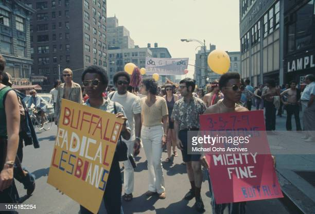 Representatives of the Buffalo Radical Lesbians take part in an LGBT parade through New York City on Christopher Street Gay Liberation Day 1971