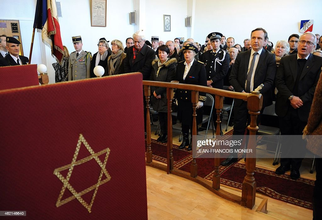 Representatives of the French Republic and Muslim, Christian and Jewish communities, attend a ceremony in the synagogue of Le Mans, western France, on January 25, 2015, in memory of the 17 victims killed in three days of terror attacks in Paris. 17 people were killed by Islamist gunmen in Paris between January 7 and 9 in a series of attacks including a massacre at the heaquarters of French satirical weekly Charlie Hebdo and a hostage taking at a Jewish supermarket.