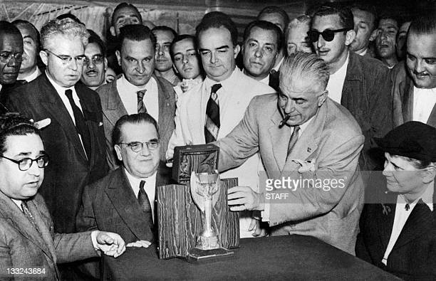 Representatives of the Italian football federation present the Jules Rimet Cup to their Brazilian counterparts 22 June 1950 in Rio de Janeiro two...