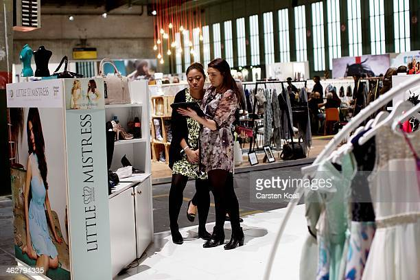 Representatives of the label Little Mistress talk at the Little Mistress brand stand at the Bread and Butter trade show at the former Tempelhof...