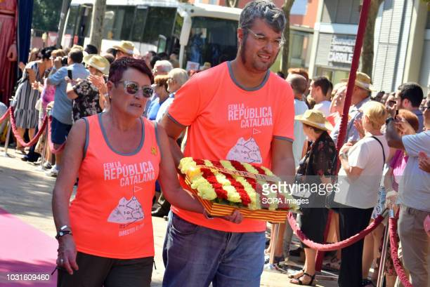L´HOSPITALET CATALONIA SPAIN Representatives of the political group Junts LH seen making a floral offering to the monument of Rafael Casanova during...