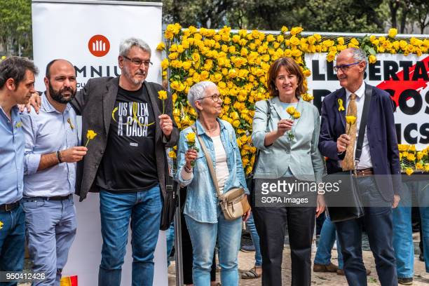 Representatives of the sovereign entities pose in front of the mural of yellow roses Catalunya celebrates the 'Day of Sant Jordi' the day of books...