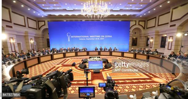 Representatives of the Syria regime and rebel groups along with other attendees take part in the session of Syria peace talks in Astana on September...