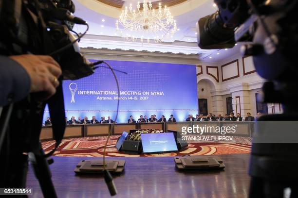 Representatives of the Syrian regime along with other attendees take part in the third round of Syria peace talks at the Rixos President Hotel in...