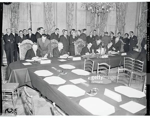 Representatives of the US England France and Germany sign history making documents at Paris creating a West European defense union which includes a...