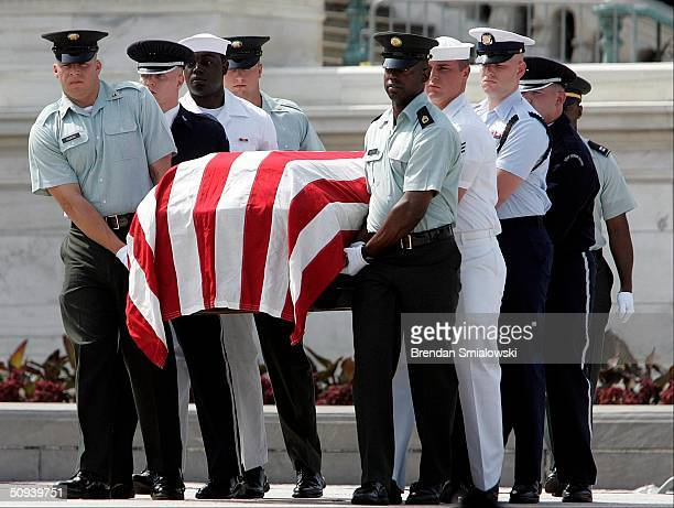 Representatives of the U.S. Military escort a casket to the U.S. Capitol building during a practice procession for the funeral of former President...