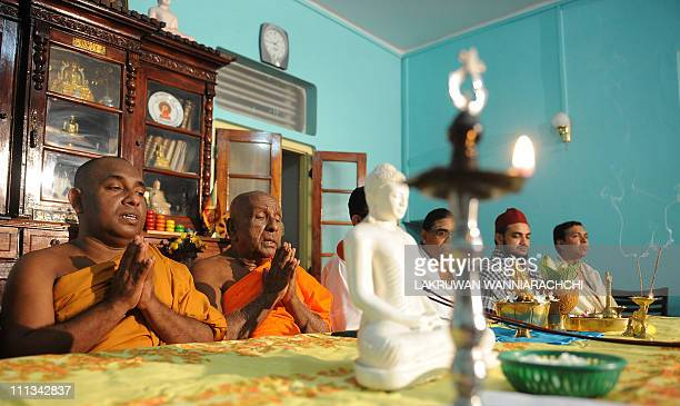Representatives of various religions pray during a religious ceremony wishing the Sri Lankan cricket team good luck in the final match of the ICC...