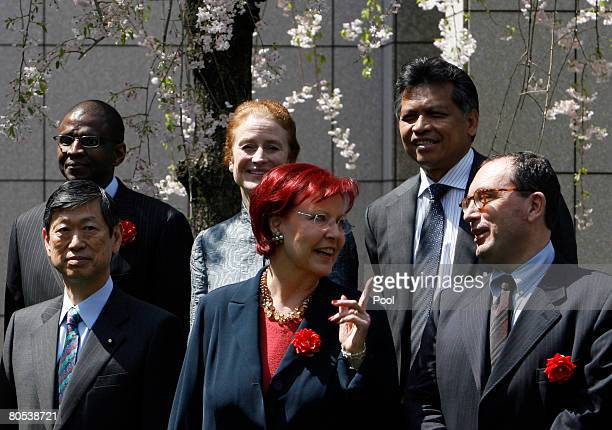 Representatives participating in the G-8 Development Ministers' Meeting pose for a group photo under cherry blossoms on April 6, 2008 in Tokyo,...