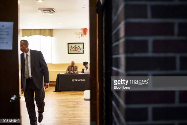 Representatives wait for job seekers to arrive during a Shades of Commerce Career Fair in the Brooklyn borough of New York US on Saturday Feb 17 2018...