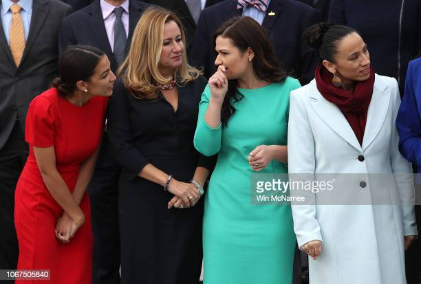 Representativeselect Alexandria OcasioCortez Debbie MucarselPowell Abby Finkenauer and Sharice Davids join with other newly elected members of the...