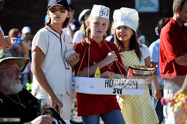 Representing baseball hotdogs and apple pie Ronja Vaitaitis Katie Bullen and Taylor Shackton watch the end of the Annual Littleton Fire Fighter's...