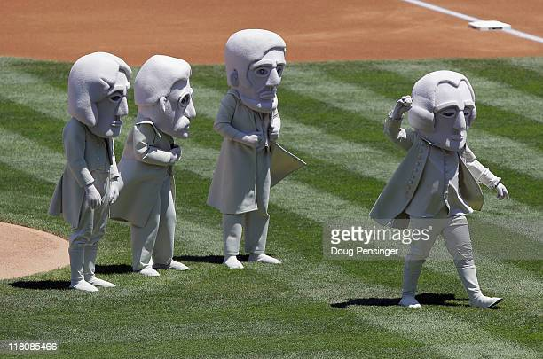 Representing the US Presidents sculpted on Mount Rushmore George Washington throws out the ceremonial first pitch as Thomas Jefferson Theodore...