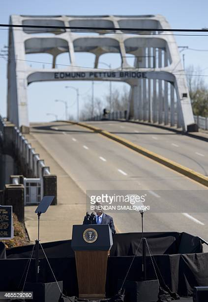 Representive John Lewis speaks at the Edmund Pettus Bridge on March 7, 2015 in Selma, Alabama. US President Barack Obama and the first family joined...