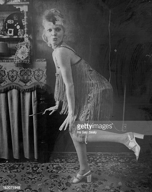 JAN 22 1976 FEB 3 1976 FEB 8 1976 A reproduction of a 1920s dress in green fringe worn by Bobble Miller recalls flapper era