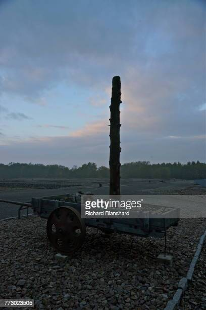 A reproduction of a hanging pole and a quarry cart filled with rocks at the Buchenwald former German Nazi concentration camp near Weimar Germany 2014...