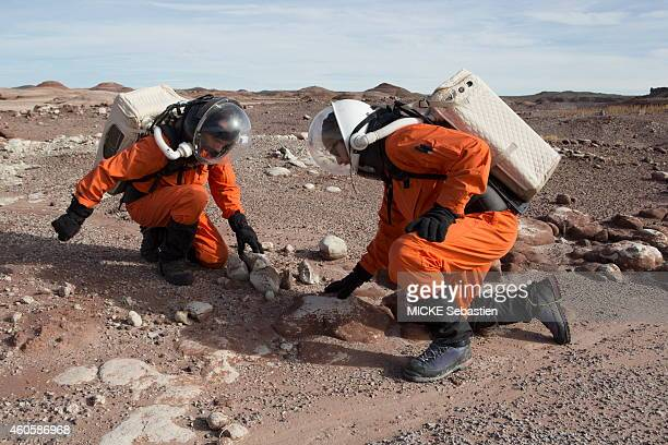 Reproduction of a space base posed in the Utah desert where six researchers from the Mars Society an international nonprofit aiming to promote the...