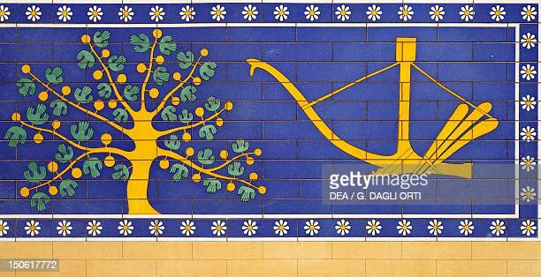 Reproduction of an enamel decoration with a tree and a plow which can be seen on the doorway to the harem of the Palace of Sargon II at DurSharrukin...