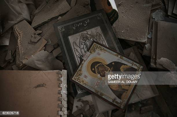 Reproduction of Christian icons lie on the ground amidst debris at the Saint Elias church in the rebelheld area of Harasta on the northeastern...