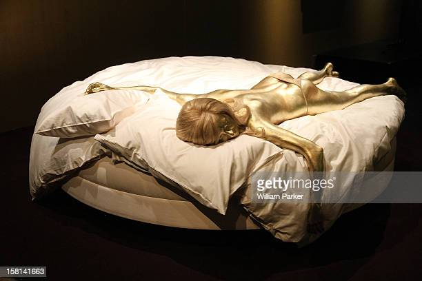 A Reproduction Of The GoldPainted Shirley Eaton As Jill Masterson In The Film Goldfinger Designing 007 Fifty Years Of Bond Style Press View