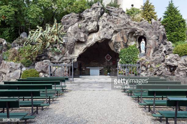 reproduction of the lourdes grotto, cannero riviera, lago maggiore, verbano-cusio-ossola province, piedmont region, italy - province of verbano cusio ossola stock pictures, royalty-free photos & images