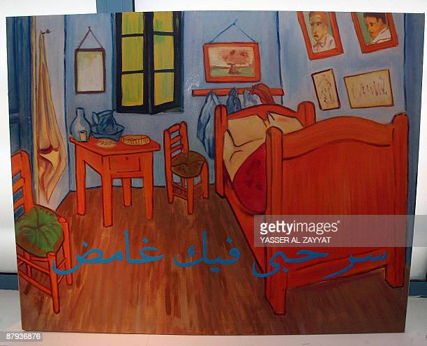 https://media.gettyimages.com/photos/reproduction-of-van-goghs-bedroom-in-arles-painting-bearing-a-quote-picture-id87936876?s=612x612