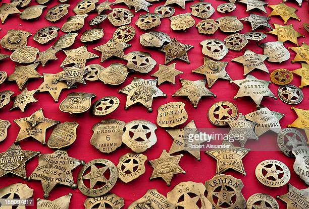 Reproduction sheriff, marshal and police badges are among the items for sale at a flea market in Santa Fe, New Mexico.