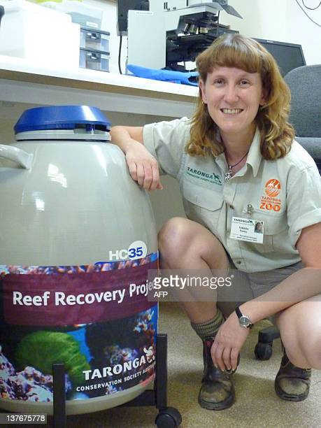 STORY SCIENCEENVIRONMENTREEFAUSTRALIAFEATURE BY Reproductive biologist Tamara Keeley with the 'Reef Recovery Project' chamber full of frozen coral...
