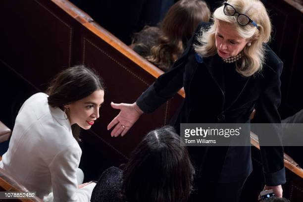Reps Alexandria OcasioCortez DNY left and Debbie Dingell DMich are seen in the Capitol's House chamber before members were sworn in on the first day...