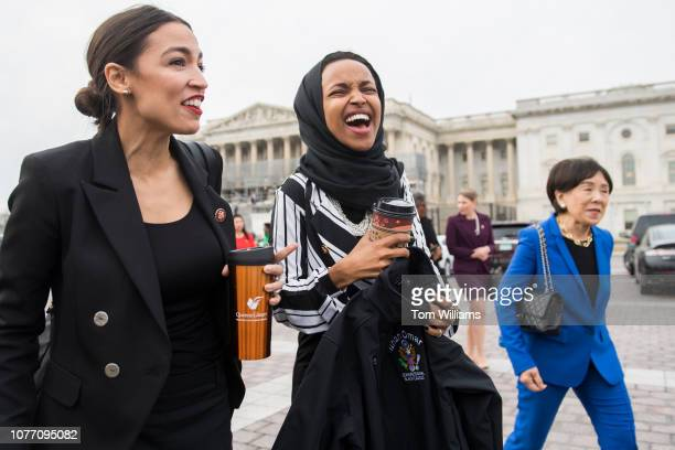Reps Alexandria OcasioCortez DNY left and Ilhan Omar DMinn arrive for a group photos with Democratic women members of the House on the East Front of...
