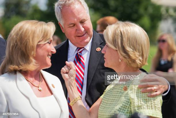 Reps Ann Wagner RMo John Shimkus RIll and Shelley Moore Capito RWVa prepare for a news conference at the House Triangle on the economic impact of the...