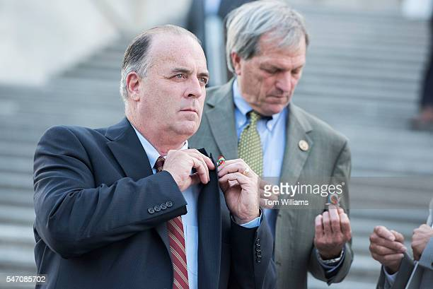 Reps Dan Kildee DMich left and Mark DeSaulnier DCalif attend a vigil on the House steps of the Capitol at which members held up pictures of the...