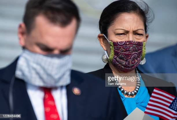 Reps Deb Haaland DNM and Richard Hudson RNC conduct a moment of silence on the House steps of the Capitol to honor victims of the September 11...