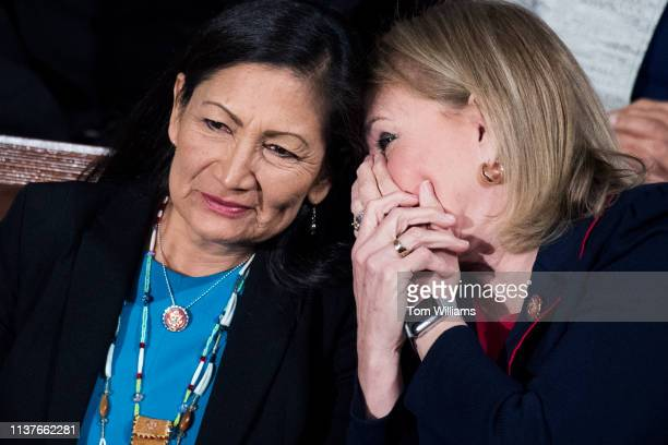 Reps Deb Haaland DNM left and Sylvia Garcia DTexas listen to NATO Secretary General Jens Stoltenberg address a joint meeting of Congress in the...