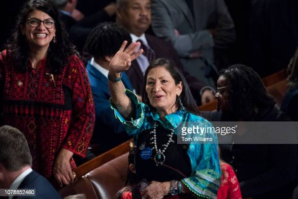 Reps Deb Haaland DNM right and Rashida Tlaib DNM left are seen in the Capitol's House chamber before members were sworn in on the first day of the...