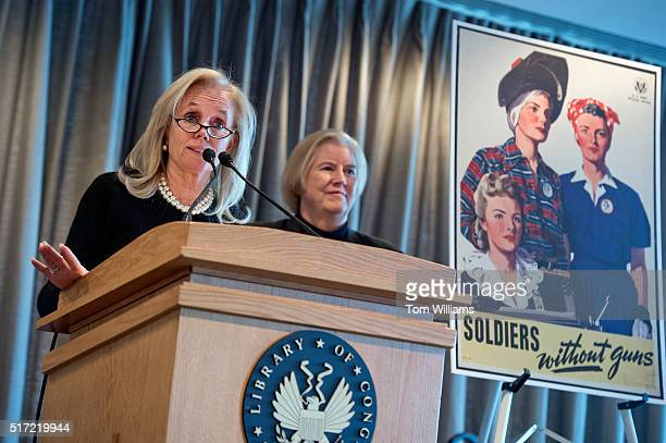 Reps Debbie Dingell DMich left and Candice Miller RMich appear during a lunch at the Library of Congress for World War II era Rosie the Riveter March...