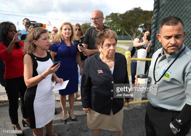 Reps Debbie Wasserman Schultz Debbie MucarselPowell and Donna Shalala wait to speak with a supervisor after being told that they would be denied...