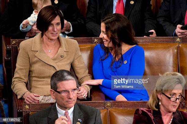 Reps Elise Stefanik RNY right and Mimi Walters RCalif are pictured during the election for Speaker before the 114th Congress was sworn in on the...