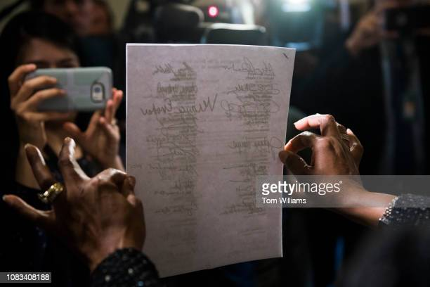 Reps Jahana Hayes DConn holds a letter in the Russell Building that was delivered to the office of Senate Majority Leader Mitch McConnell RKy calling...