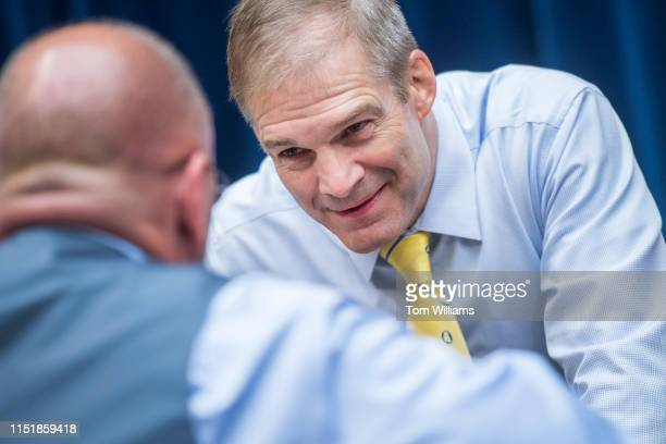 Reps Jim Jordan ROhio right and Clay Higgins RLa are seen during a House Oversight and Reform Committee hearing in Rayburn Building on security...