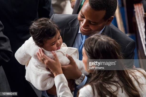 Reps Joe Neguse DColo his daughter Natalie and Alexandria OcasioCortez DNY are seen in the Capitol's House chamber before members were sworn in on...
